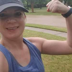 showing off my muscles, dripping with rain after completing a 15k